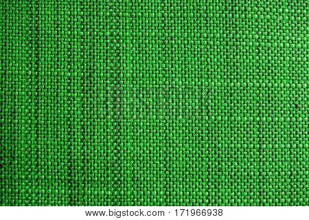 Green fabric texture. Cloth background. Close up view of green fabric texture and background. Abstract background and texture for designers.