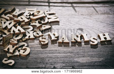 Word Spanish Made With Wooden Letters.