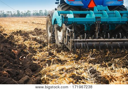 Agricultural machinery in the field. Cultivator close-up.