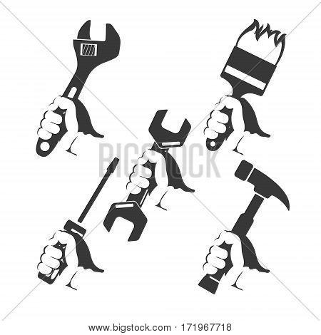 Repair tools in hand silhouette set vector