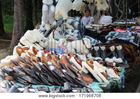 Schodnica Ukraine - June 30 2014: People near trade stalls with ukrainian souvenirs