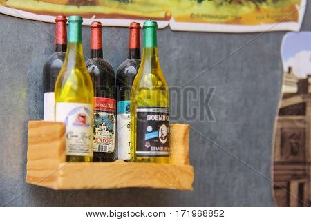 Mukachevo Ukraine - July 2 2014: Bottles of alcohol by Ukrainian production on a wooden shelf