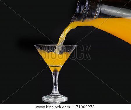 Pouring Orange Juice Into Glass, Fresh Pouring Orange Juice With Fruits On Black Background