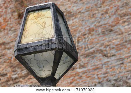 Original lantern in retro style on brick wall background. Mukachevo Ukraine