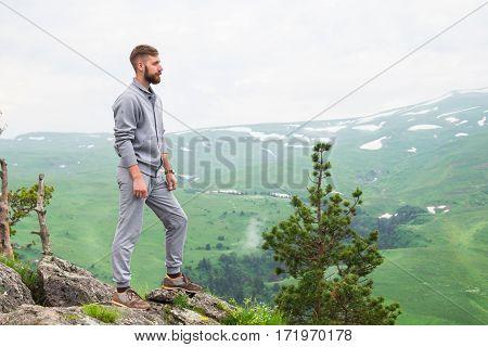 Hipster Man On Top Of Mountain. Conceptual Design.