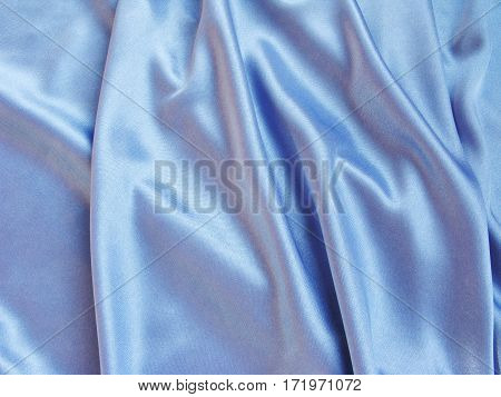 shiny satin blue material as fashion background