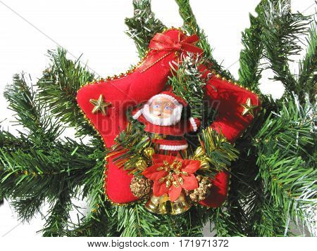 christmas santa claus on a fir branch on white background isolated