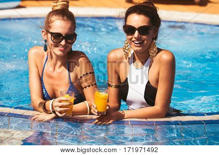 Happy Girl Friends With Drinks By The Pool