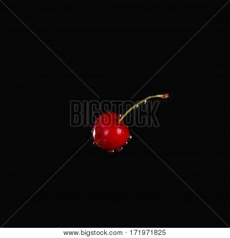 Cherry With Water Drops Over Black Background
