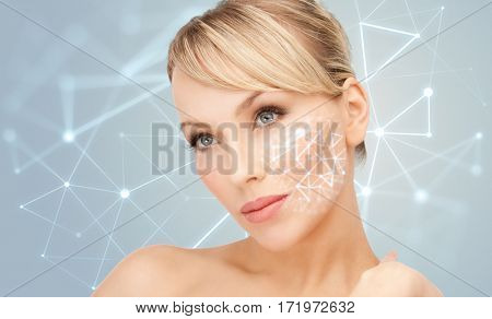 beauty, people, skincare and plastic surgery concept - beautiful young woman over gray background with low poly projection
