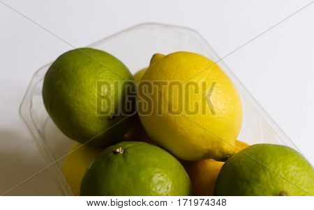 Beauty green limes and yellow on neutral background