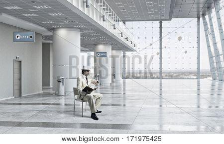 Elegant businessman read old book . Mixed media