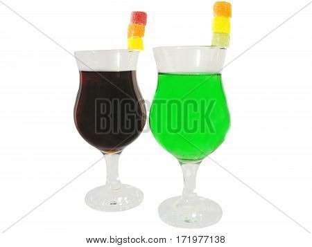 two glasses of green and brown cordials cocktails