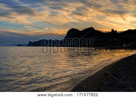 Sunset over East Crimean cost near an ancient Genoese fortress in Sudak Crimea Ukraine