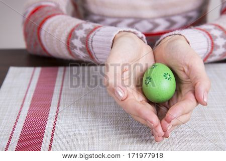 Green Colored Easter Egg In Female Hands