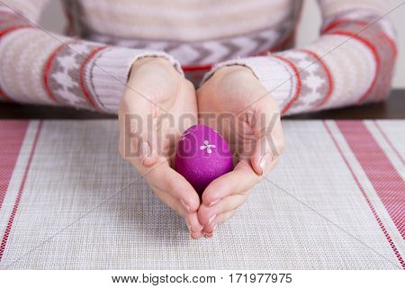 Crimson Colored Easter Egg In Female Hands