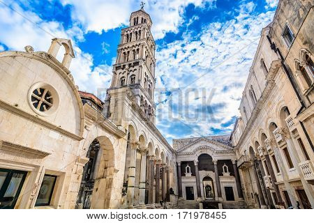 Marble ancient roman architecture in city center of town Split, view at square Peristil in front of cathedral Saint Domnius and  bell tower landmarks, Croatia.