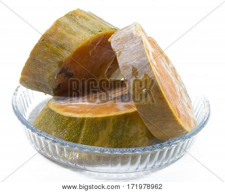 Deteriorated rotten pumpkin pieces in pyrex isolated