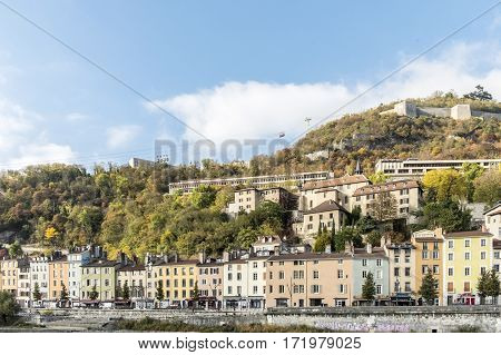 Cityscape View With  River And Bridge In Grenoble