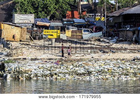 Young Boys Play And Work In The Dirts  Litter Area At The River Ganges, The Slums Of Calcutta