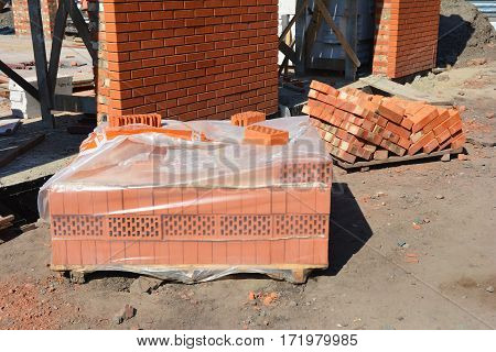 Brick building material on the construction site