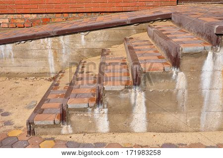Building ramp for wheelchair entry and steps. Brick ramp way for support wheelchair disabled people.
