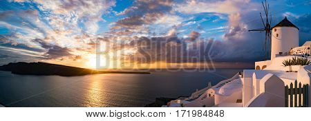 Oia village panorama, view of Santorini caldera at sunset , Santorini island, Greece
