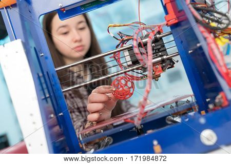 Young woman, schoolgirl print 3D model on 3D printer