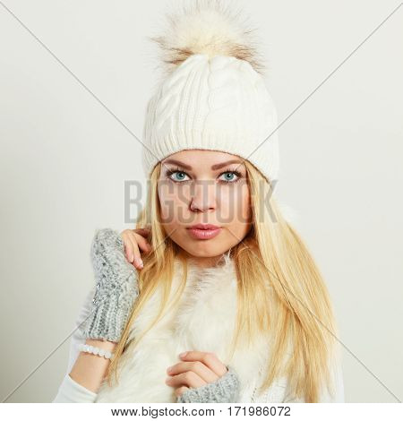 Clothing fashion people. Attractive woman wearing winter clothes. Young lady has knitted wool sweater.