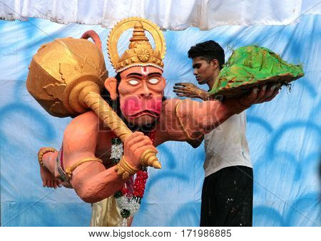 Goa, India - Feb 16, 2008: Indian Man Making A Sculpture Of Hindu God Hanuman (widely Venerated Thro