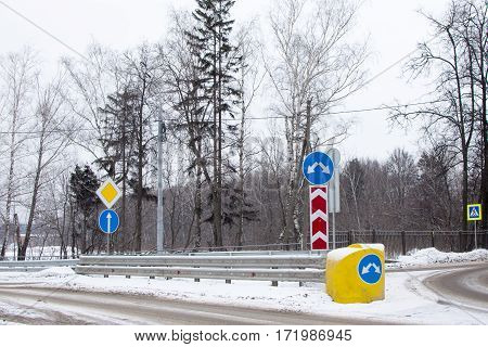 Road Signs At The Intersection. Winter Landscape