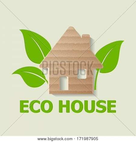 Cardboard house and green leaves. Ecology concept.