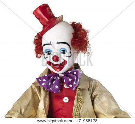 Clown doll with red top hat and spotted bow tie isolated on white
