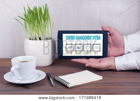 Content Management System. Digital tablet computer with isolated screen in male hands.