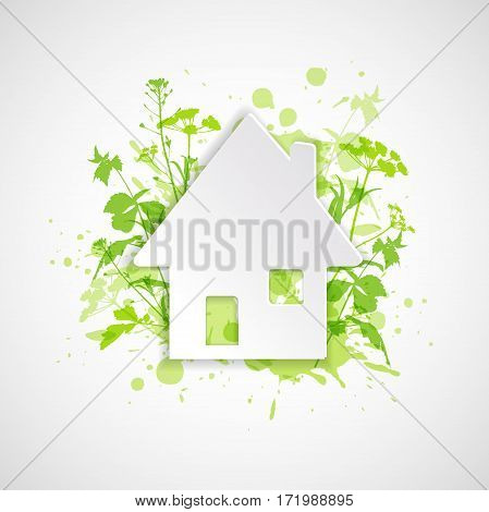 White paper house and green plants. Ecology building concept. Abstract background.