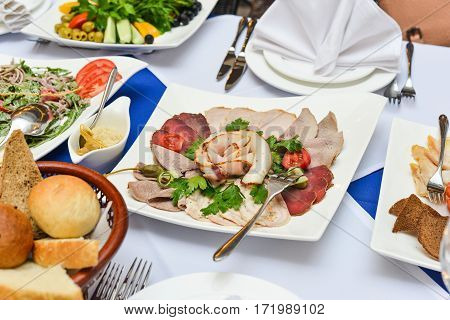 buffet table, Canape, sandwiches, snacks holiday table sliced glasses celebration