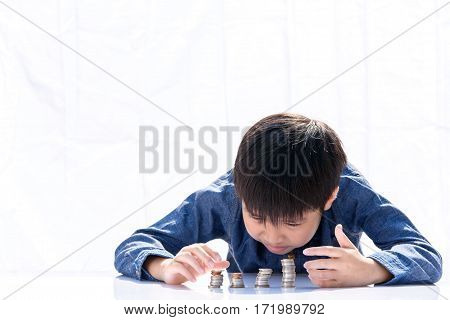 Boy Building Coin Tower