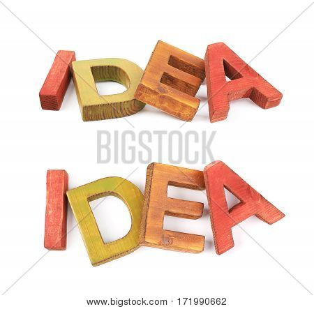 Word Idea made of colored with paint wooden letters, composition isolated over the white background, set of two different foreshortenings
