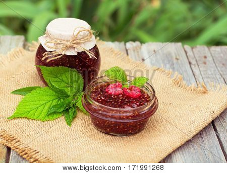 Raspberry Jam And Fresh Raspberry On A Rustic Wooden Table. Dof