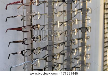 row of glasses at an opticians in magazine