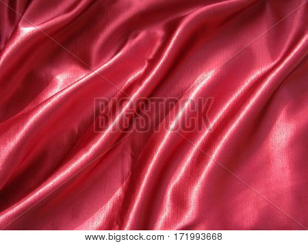 shiny satin red material as fashion background