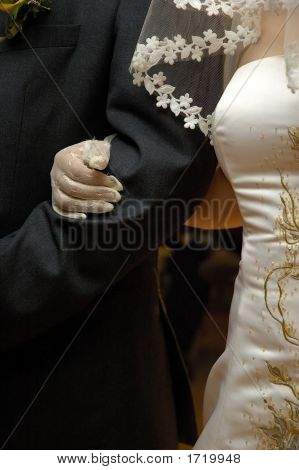 Bride'S Arm Over Groom