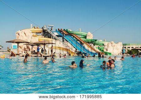 people swimming in the water park pool hotel in Hurghada. Egypt.