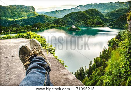 crossed feet lake aerial bled slovenia relax travel