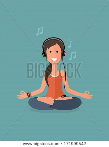 Girl brunette practicing yoga. The girl meditates with music.