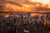 Victoria peak victoria harbor Hongkong city Kowloon city and building view with sunrise Hong kong China poster
