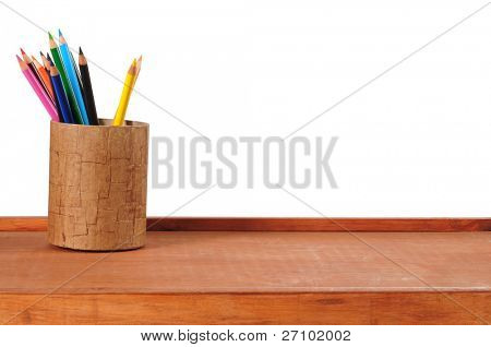 Color pencils on desk. Isolated