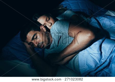 Couple Sleeping In Bed. The Sleeping Couple Relax In The Bed. Night Time
