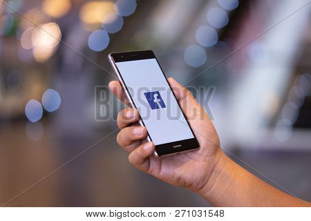Chiang Mai, Thailand - Oct. 28,2018: Man Holding Huawei With Facebook App On The Screen. Facebook Is