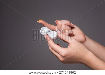Contact Eye Lens. Close-up Of Woman Hands Holding White Eye Lense Container. Woman Fingers Holding E